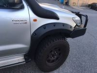 HILUX 11-15 BOLTED UNPAINTED FRONT FLARES