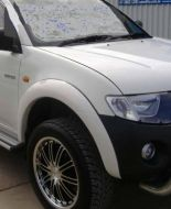 TRITAN ML 06+ FRONT ONLY